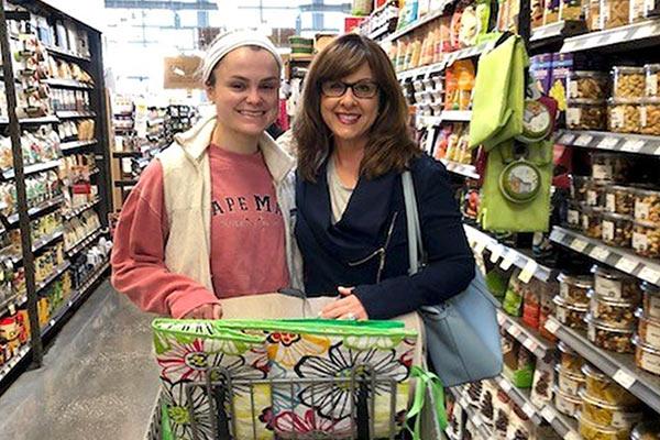 Nicole and Coach Jacob Heath shopping on the supermarket